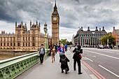 People Taking Photographs On Westminster Bridge, London, England.