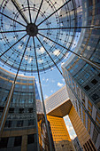 View looking up at modern architecture of La Defense, Paris France.