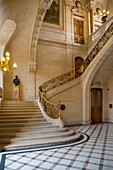 Marble staircase in the Richelieu section of Musee du Louvre, Paris, France.