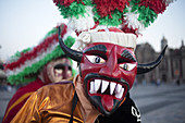 A dancer from Chocaman, Veracruz, dressed as a red devil, dances the Danza de los Santiagos at the pilgrimage to Our Lady of Guadalupe Basilica in Mexico City, Mexico, December 8, 2013.
