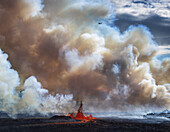Volcano Eruption, Holuhraun-near the Bardarbunga Volacano, Iceland. Thick Plumes and Lava Fountains with a small plane flying over the eruption site. August 29, 2014 a fissure eruption started in Holuhraun at the northern end of a magma intrusion, from th