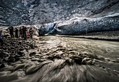 People exploring an ice cave, Breidamerkurjokull Glacier, Vatnajokull Ice Cap, Iceland.