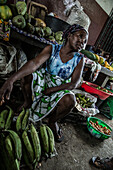 Local woman selling bananas on a public marketplace, Sao Tome, Sao Tome and Principe, Africa