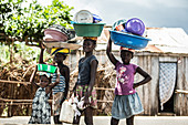 Little native children carrying their dishes in bowls on their heads, Sao Tome, Sao Tome and Principe, Africa