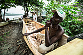 Old native fisherman in his simple boat, Sao Tome, Sao Tome and Principe, Africa