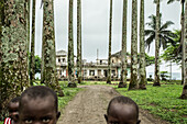 Native little children in front of a simple house, Sao Tome, Sao Tome and Principe, Africa