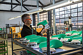 Fagus Factory, interior, employee, shoe last production, plastic, Walter Gropius designed building, heritage, Unesco World Heritage Site, Alfeld, Lower Saxony, Germany