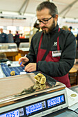 weighing white truffles at the Alba Truffle Fair, Market, scales, Alba, Piedmont, gourmet, luxury, Cuneo, Italy