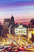 'Metropolis building seen from ''Puerta de Alcala'' monument by sunset. Madrid, Spain.'