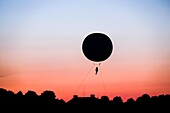 A balloon in the sky with sunset in the Herrenhausen Gardens, Hanover, Germany.