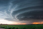 Striated supercell passes just north of Grand Island Nebraska May 10, 2005 producing large hail and lightning during twilight.