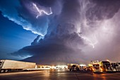 Amazing supercell storm during twilight nears a York Nebraska truck stop on I80 as it spits out lightning, June 17, 2009. Only a half hour or so earlier this storm was producing a long-lived large tornado near Aurora Nebraska.