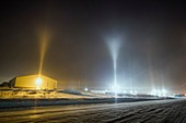 Y-shape light pillars form in Blair Nebraska in freezing temps and from conditions related to steam production from a corn milliing plant. At times the V shape on top was nested with another V above it, which is rare.