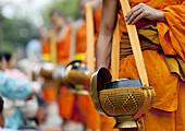 Lao Buddhist Monks Collecting Alms, Luang Prabang, Laos.