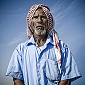 Saudi man wearing the shemagh, which is the traditionnal headdress for Arab men.