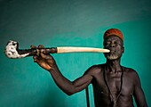 Benin, West Africa, Taneka-Koko, traditional healer called mister tcholi with his giant pipe.