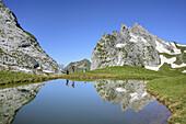 Two persons hiking at mountain lake, Schweizer Tor, Raetikon trail, Raetikon, Vorarlberg, Austria