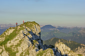 Two persons hiking and posing, Ammergauer Hochplatte, Ammergau Alps, East Allgaeu, Allgaeu, Swabia, Bavaria, Germany