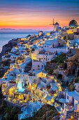 Iconic sunset in the town of Oia on the greek island Santorini (Thera). Santorini, classically Thera and officially Thira, is an island in the southern Aegean Sea, about 200 km (120 mi) southeast of Greece´s mainland. It is the largest island of a small,