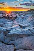 'The Bisti/De-Na-Zin Wilderness is a 45,000-acre wilderness area located in San Juan County in the U. S. state of New Mexico. Established in 1984, the Wilderness is a desolate area of steeply eroded badlands managed by the Bureau of Land Management, with
