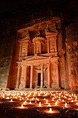 'The famous and elaborately carved façade of Al Khazneh (the Treasury), carved out of a sandstone rock face, lighted with candles during ''Petra by night''. Jordan (Hashemite Kingdom of), Ma´an Governorate (Maan), ancient city of Petra.'