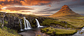 Panorama of Kirkjufell mountain and waterfall at sunset Snaefelness Peninsula prime tourist destination Iceland