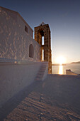 Bell tower of the white domed church of Panagia Thalassitra at sun, Milos, Cyclades Islands, Greek Islands, Greece, Europe.
