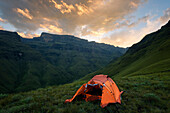 Landscape photo of a sunset over the uMhlambonja valley. Cathedral Peak Region, Drakensberg, South Africa.