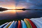 Landscape photo of canoes on a lagoon shore. Kleinmond, Western Cape, South Africa.