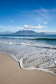 Landscape photo of a perfect summer day at the beach. Bloubergstrand, Cape Town, South Africa.