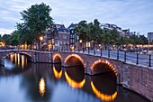Reguliersgracht Canal at night. The historic centre of Amsterdam and its canals have been designqted a World Heritage Site by UNESCO.