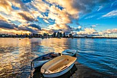 San Diego Harbor and boats during a vibrant sunrise illuminating clouds. San Diego, California, United States.