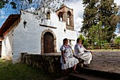 Two local women in Attaco church