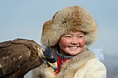Portrait of a Kazakh teenage girl eagle hunter (winner of 2014 competition) at the Golden Eagle Festival on the festival grounds near the city of Ulgii (Ölgii) in the Bayan-Ulgii Province in western Mongolia.