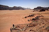 Desert of sand and rocks, Jebel Khazali area. Jordan, Wadi Rum desert, protected area inscribed on UNESCO World Heritage list. Model Released.