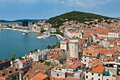 Split, Dalmatian Coast, Croatia. High overall rooftop view with harbour. The tower is the 15th century Venetian Marina Tower in Brace Radic Square. The Historic Centre of Split is a UNESCO World Heritage Site.