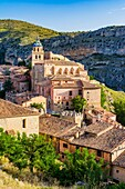 The bell tower of the Cathedral of San Salvador stands out among the roofs of Albarracin buildings. Albarracin, Teruel, Aragón, Spain, Europe.
