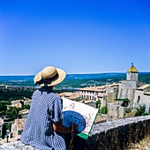 Middle aged woman drawing Aurel perched village, Vaucluse, Provence, France.