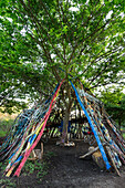 Urban teepee tent fort found in a local city park within Raleigh, North Carolina The artist desired to create a welcoming place for children to play This structure enabled that youthful fun while costing virtually no money