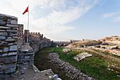 'Selcuk Castle and the Turkish flag; Ephesus, Turkey'