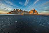 'The tidal flats at low tide at Vestrahorn, also known as Stokknes in Eastern Iceland; Iceland'
