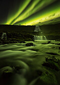 'Northern lights over Dynjandi in the Westfjord region of Iceland, Dynjandi is a series of seven waterfalls; Westfjords, Iceland'