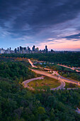 'Sunset looking south over the Don Valley, Bloor on-ramp, Toronto skyline and Don Valley Parkway; Toronto, Ontario, Canada'