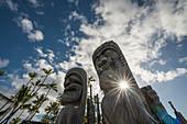 'Afternoon sun shines through statues at Puuhonua O Honaunau National Historic Park; Island of Hawaii, Hawaii, United States of America'