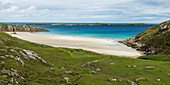 'A white sand beach and turquoise water along the coast of the Highlands; Scotland'