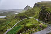 'A road winding through the mountains, Highlands; Staffin, Scotland'