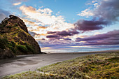 'A sunset at the surf beach of Piha, just outside of Auckland; New Zealand'