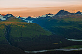 Scenic view along Thompson Pass with Wortmanns Glacier in the background and Wortmanns Creek joining the Lowe River, Southcentral Alaska, summer
