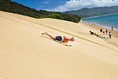 'Sand Boarding the Hokianga Sand Dunes on the Tasman Sea; Hokianga, New Zealand'