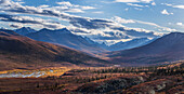 Scenic autumn view of mountains and colorful tundra in Tombstone Territorial Park, Yukon Territory, Canada
